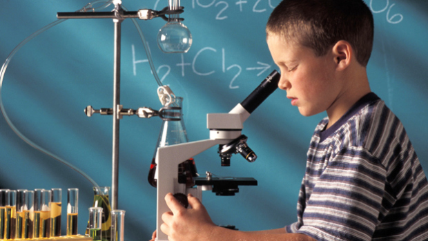 photo of a boy with a microscope