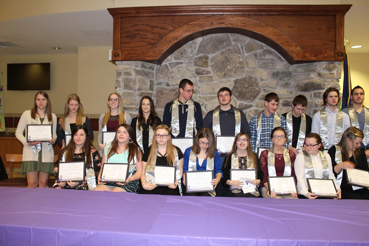 photo of honored students holding awards