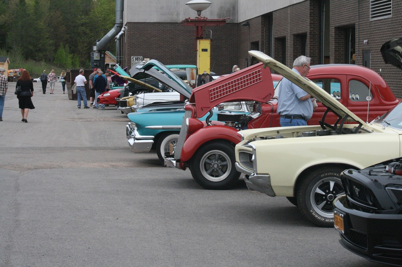 photo of old cars with hoods open at open house showcase event