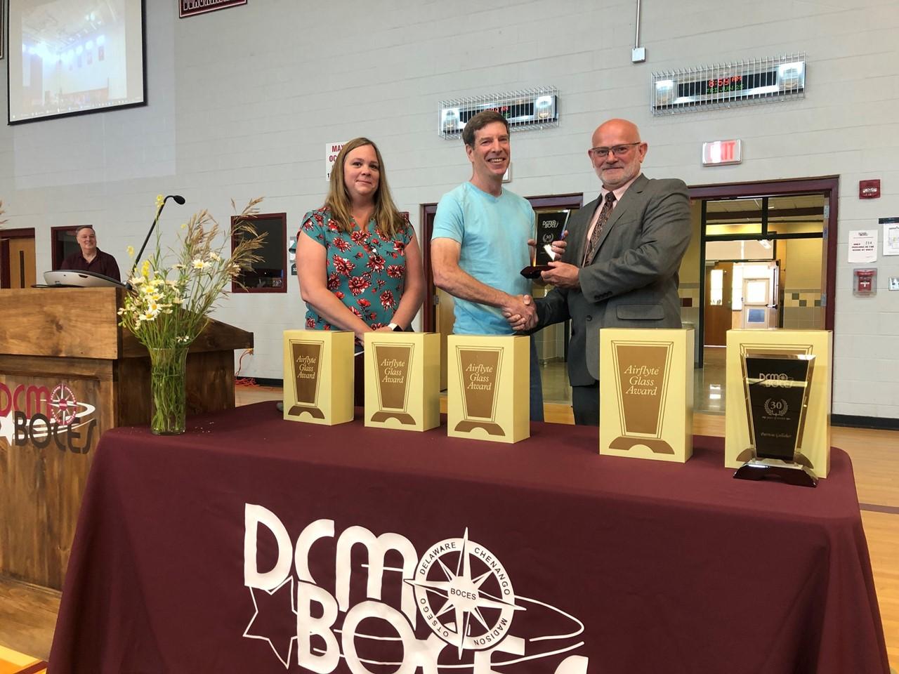 photo of staff member receiving award