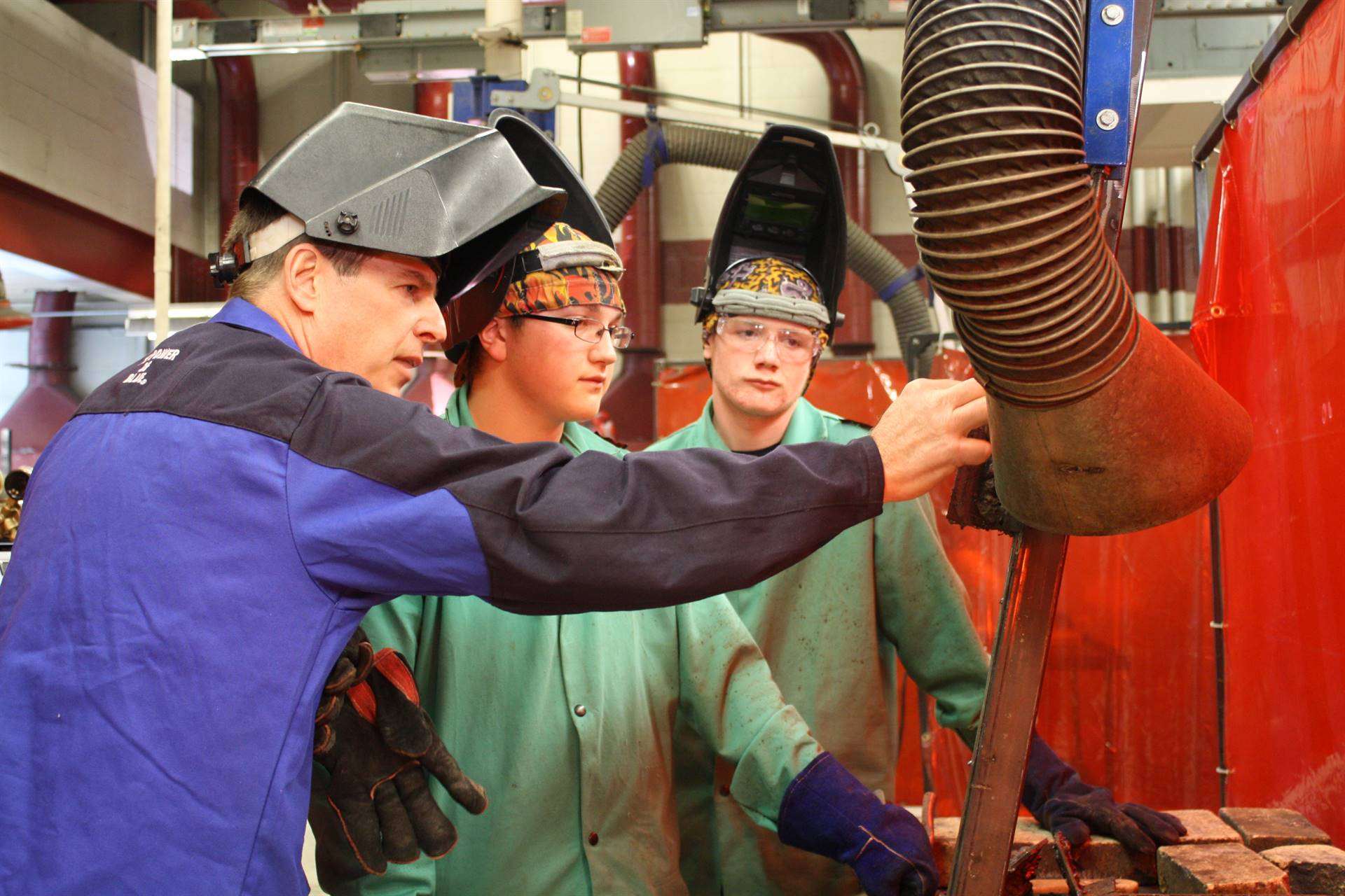 welding instructor teaching students