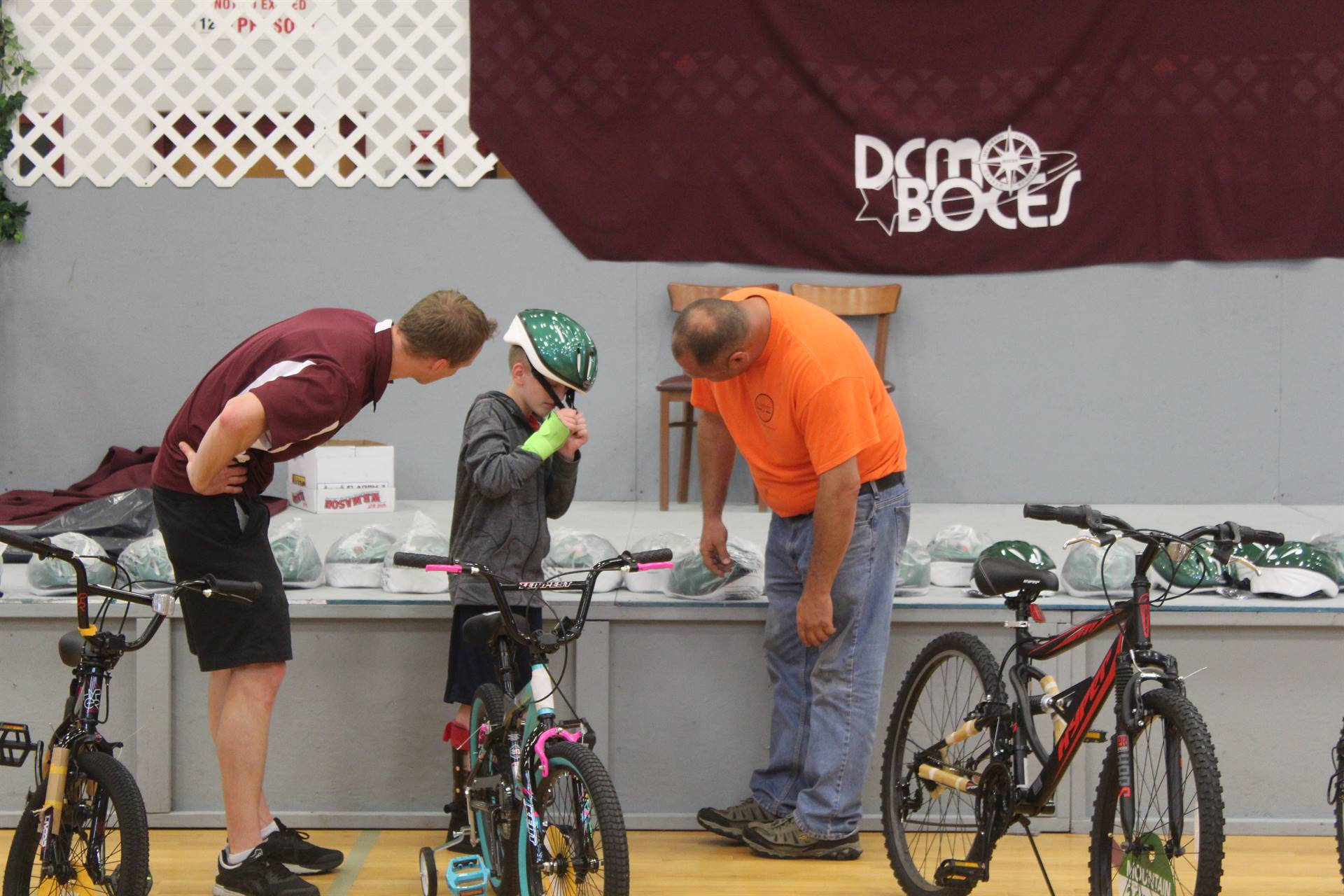 vendor donating bicycles to students