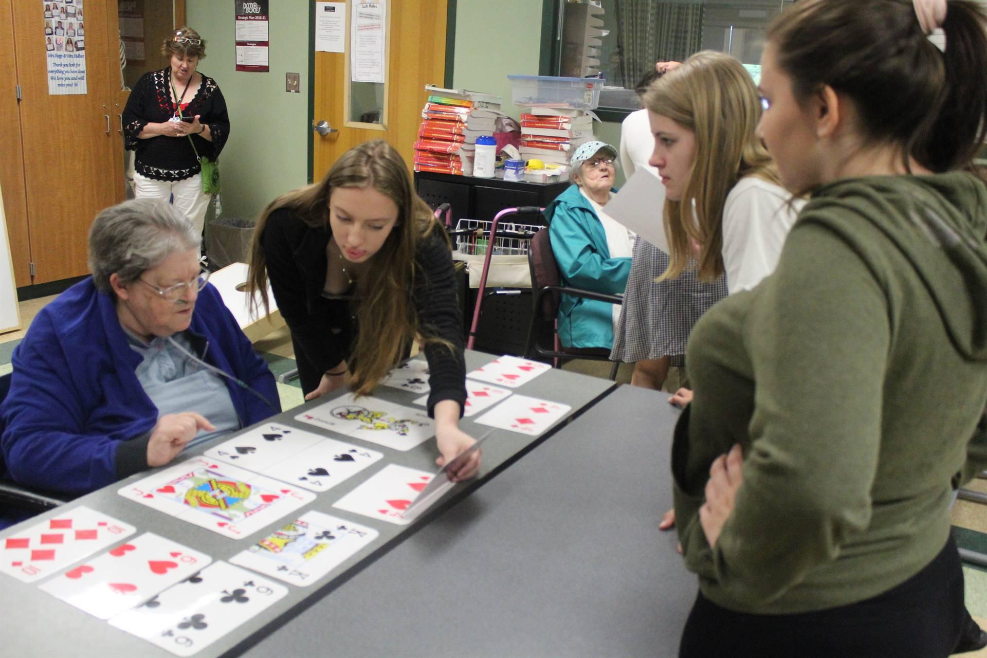 students assisting patient at rehabsite