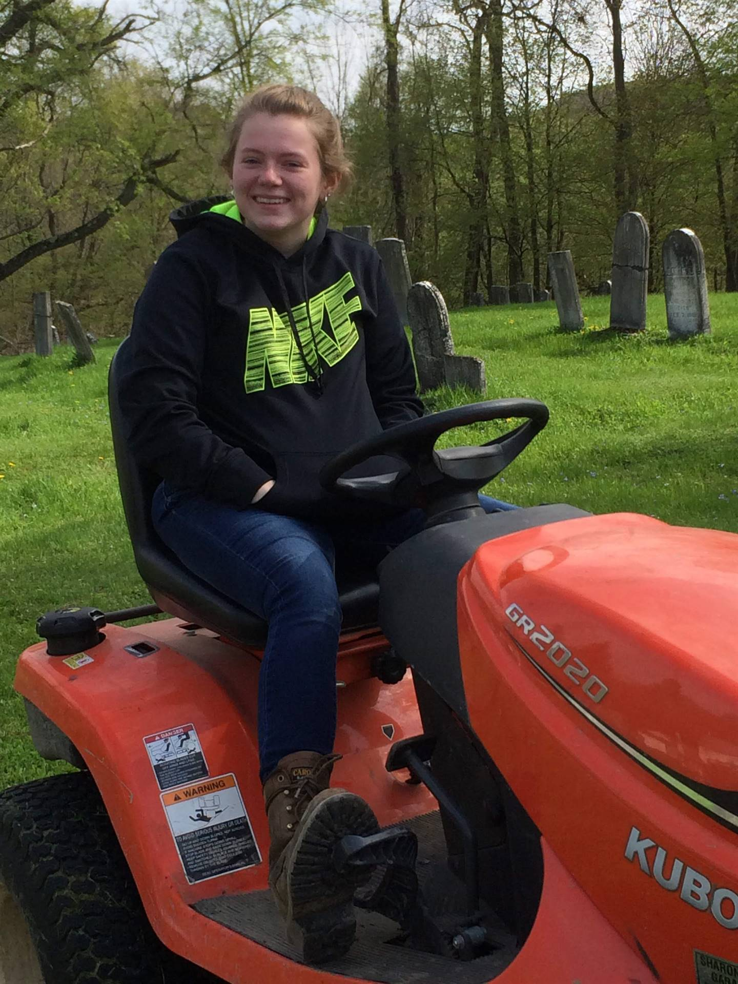 student mowing the lawn